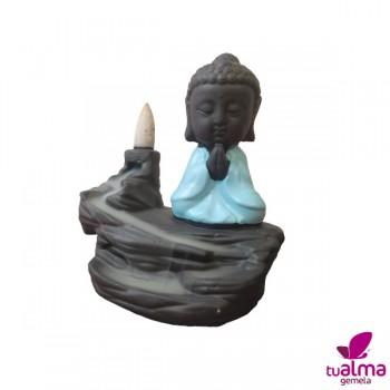 fuente de humo buda meditando azul